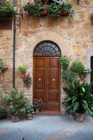 wooden facade: wooden residential doorway in Tuscany. Italy