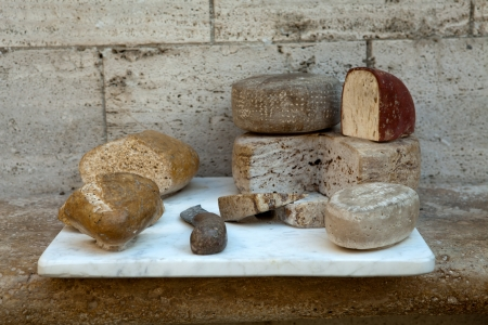 Tuscan cheeses and the bread performed  of stone photo