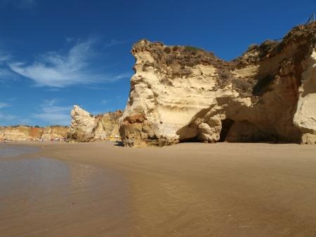 region of algarve: A section of the idyllic Praia de Rocha beach on the Algarve region.  Stock Photo