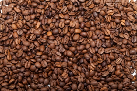 coffee beans close up isolated on white Stock Photo - 17939177