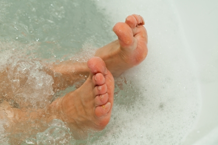 the water massage of tired feet photo