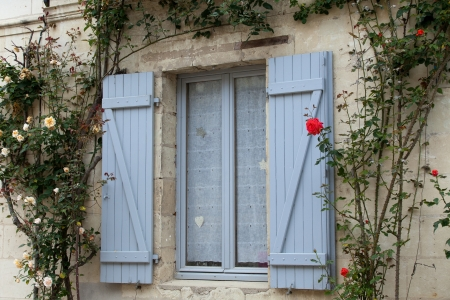 The romantic window with red roses photo