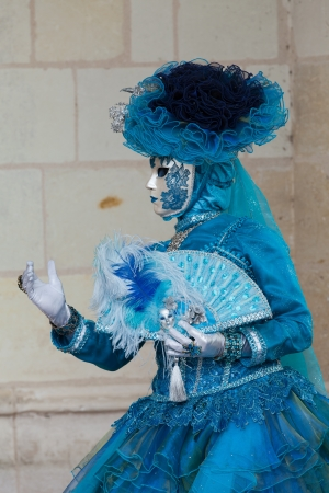 The blue lady in the carnivalesque costume  and venetian mask Stock Photo - 21228371