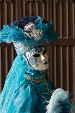 The blue lady in the carnivalesque costume  and venetian mask Stock Photo - 21267369