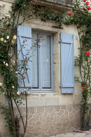 The romantic window with red roses Stock Photo - 21336710