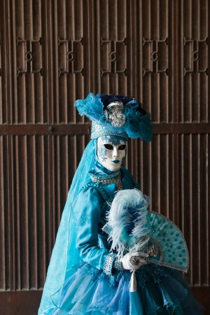 The blue lady in the carnivalesque costume  and venetian mask Stock Photo - 21733372