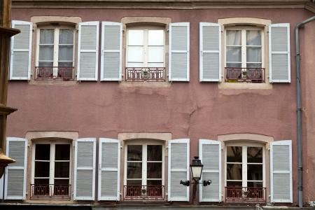 chinon: the facade with white window shutters Stock Photo