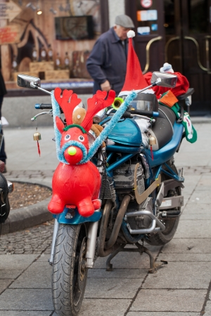 The parade of Santa Clauses on motorcycles around the Main Market Square in Cracow photo