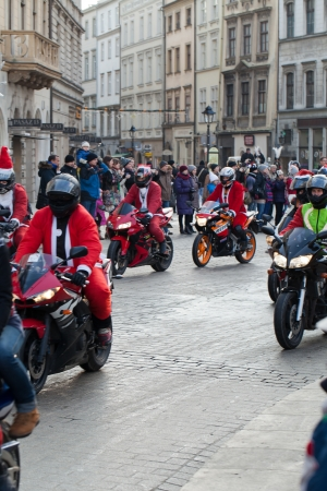 The parade of Santa Clauses on motorcycles around the Main Market Square in Cracow