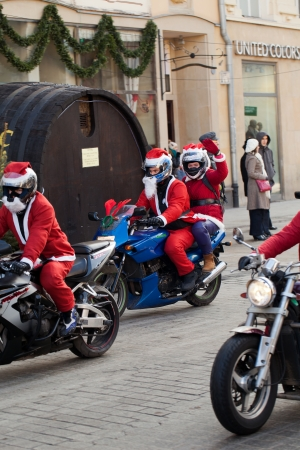 clauses: The parade of Santa Clauses on motorcycles around the Main Market Square in Cracow Editorial