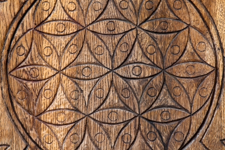 Wooden Flower of Life.  The Flower of life is an ancient symbol of Sacred Geometry and represents the fundamental order of creation.  photo