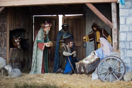 jesus mary joseph: Christmas nativity scene with three Wise Men presenting gifts to baby Jesus, Mary & Joseph
