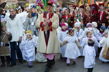 Cracow, Poland - January 5, 2014  Biblical Magi Three Wise Men parade  around the Main Market Square in Cracow