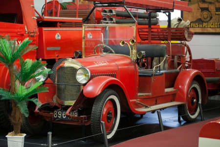 antique fire truck: VALENCAY, FRANCE - JUNE 19, 2013:  Automobile Museum Valencay shows  about sixty cars from 1898 to 1965 which are all in capacity to run. The old fire truck