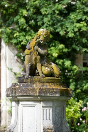 touraine: The sculpture of the child with the dog  in the garden of the castle in  Montresor