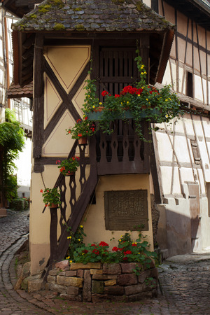 fachwerk: Street with half-timbered medieval houses in Eguisheim village along the famous wine route in Alsace, France