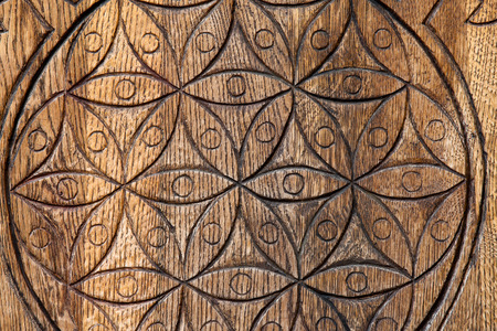 Wooden Flower of Life.  The Flower of life is an ancient symbol of Sacred Geometry and represents the fundamental order of creation.