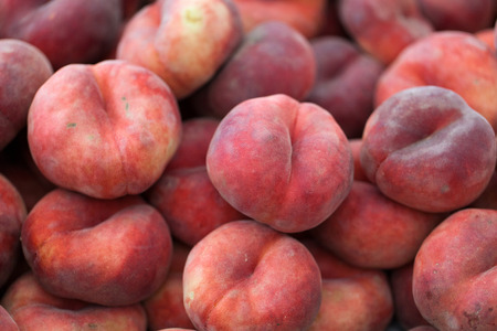 Saturn peach or chinese flat peaches 스톡 콘텐츠
