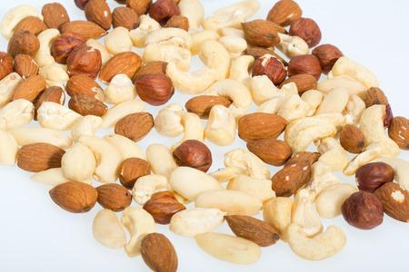 cobnut:  mixed nuts  -  hazelnuts, walnuts, cashews,  pine nuts isolated on white background