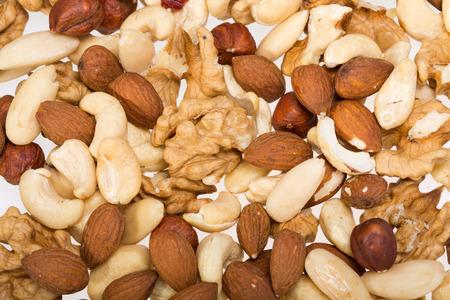 cobnut: background of mixed nuts -  hazelnuts, walnuts, cashews,  pine nuts Stock Photo