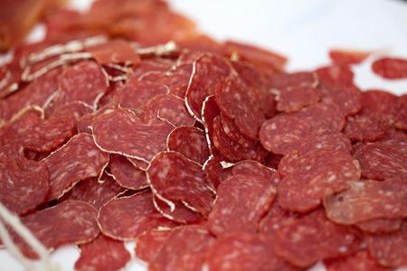 longaniza: Close-up traditional sliced meat sausage salami Stock Photo