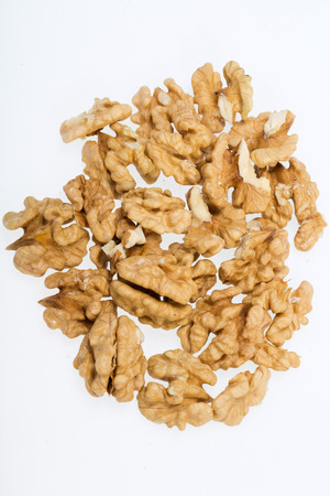 craked:  cracked walnut isolated on the white background  Stock Photo