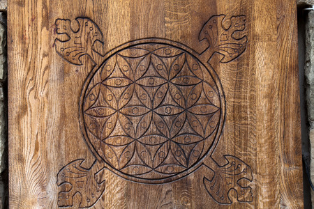 Wooden Flower of Life.  The Flower of life is an ancient symbol of Sacred Geometry and represents the fundamental order of creation. Stock Photo - 26457093