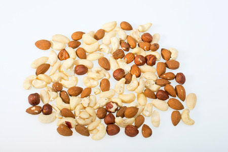 whole pecans:  mixed nuts  -  hazelnuts, walnuts, cashews,  pine nuts isolated on white