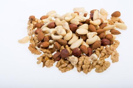 cobnut:  mixed nuts  -  hazelnuts, walnuts, cashews,  pine nuts isolated on white