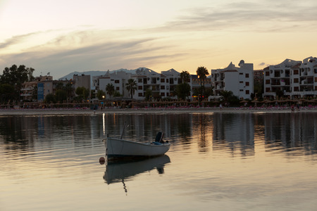 skiff: Beautiful Sunset scene with a small boat