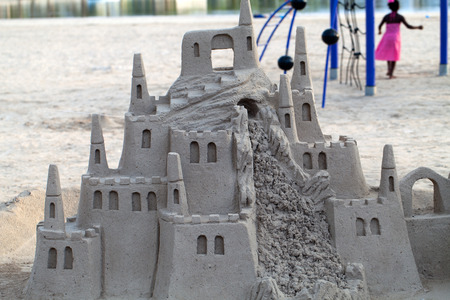 A beautiful sand castle on a beach.  photo