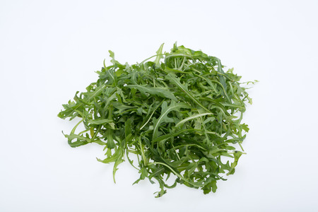ruccola: Heap of ruccola leaves isolated on white background