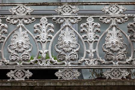 beautifully adorned iron balustrade of the balcony photo