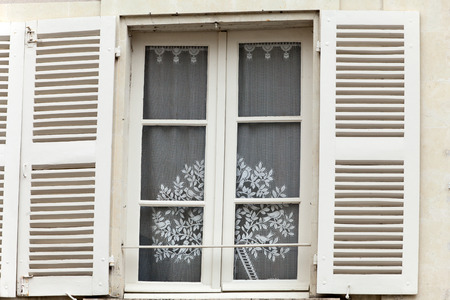 chinon: White window with shutters