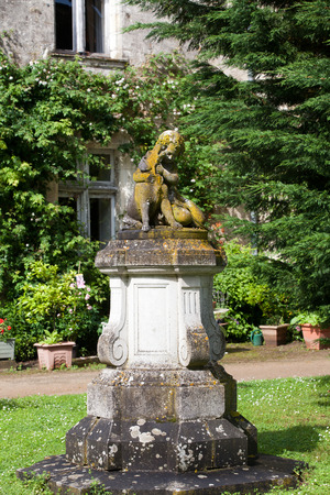 esteemed: The sculpture of the child with the dog  in the garden of the castle in  Montresor