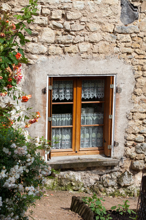 The romantic window with red roses Stock Photo