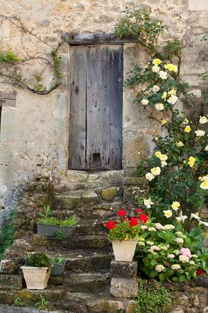 cottage with roses around door  photo