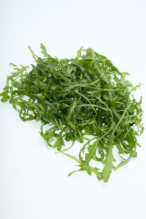 ruccola: Heap of ruccola leaves isolated on white
