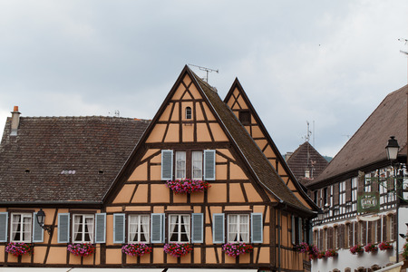 Timbered houses in the village of Eguisheim in Alsace, France photo