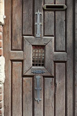 usse: ancient brown wooden door Stock Photo