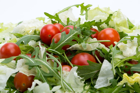 ruccola: Heap of ruccola, lettuce leaves and cherry tomatoes