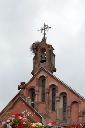 foretop:  Church of Eguisheim village along the famous wine route in Alsace, France