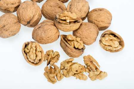 craked: walnut and a cracked walnut isolated on the white background  Stock Photo