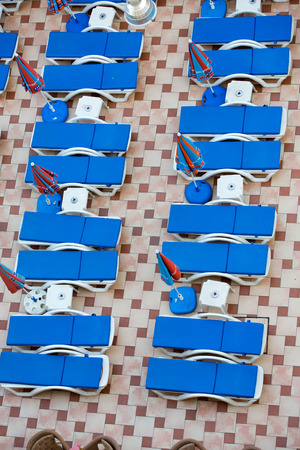 Swimming pool and poolside loungers photo