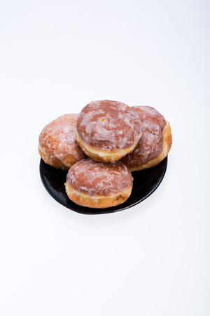 whole donuts on the black porcelain plate photo