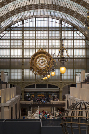 PARIS -SEPTEMBER 7, 2014: Golden clock of the museum DOrsay in Paris, France. Musee dOrsay has the largest collection of impressionist and post-impressionist paintings in the world.
