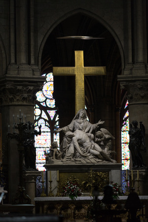 Paris - Notre Dame Cathedral. The Statue of La Pieta on the Main Altar . France