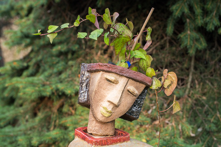 the flower pot in the form of the feminine head photo