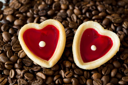 teacake: two sweet hearts and coffe beans Stock Photo