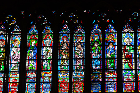 north window arch: Stained glass windows inside the Notre Dame Cathedral. Paris, France